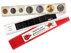 Three custom plastic rulers with coins, morse code and company logo