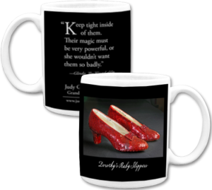 Ruby slippers on black background with quotation on ceramic mug