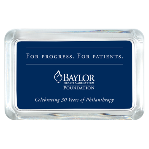 Rectangle glass paperweight with navy background Baylor Health Care System Foundation logo and slogan