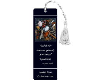Custom Laminated bookmark for restaurant has black background and food image with quote that says