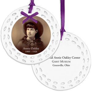 Custom made round ceramic ornament with Annie Oakley and purple bow and ribbon